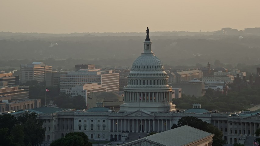 5K stock footage aerial video of the United States Capitol, revealing Washington Monument, Washington D.C., sunset Aerial Stock Footage | AX76_089