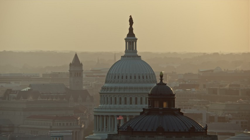 5K stock footage aerial video of the United States Capitol and Thomas Jefferson Building domes, Washington D.C., sunset Aerial Stock Footage   AX76_090E