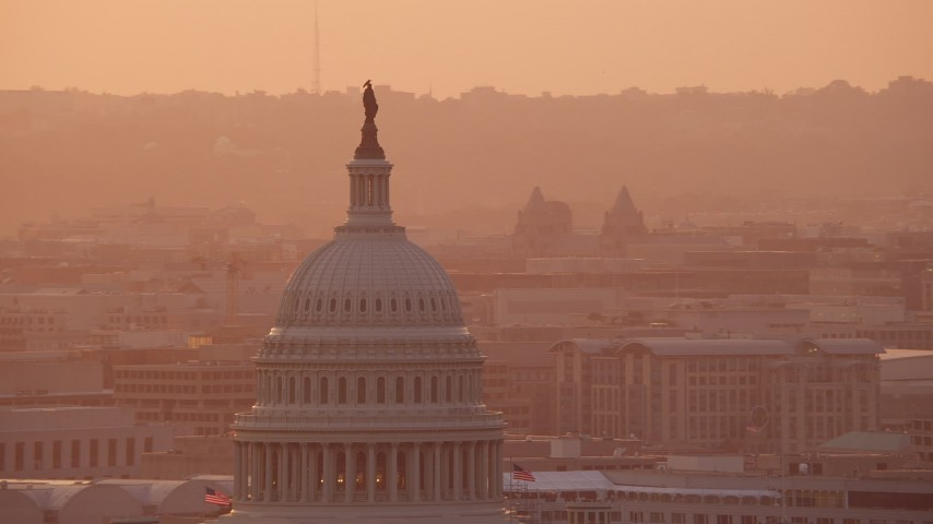 5K stock footage aerial video tilting to the United States Capitol dome, Washington D.C., sunset Aerial Stock Footage | AX76_091