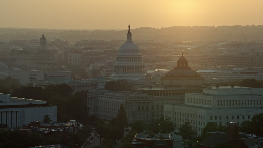 5K stock footage aerial video of the United States Capitol, Thomas Jefferson and John Adams buildings, Washington D.C., sunset Aerial Stock Footage | AX76_095