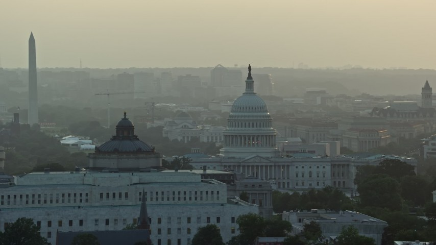 5K aerial video Library of Congress, United States Capitol, Washington Monument, Supreme Court, Washington D.C., sunset Aerial Stock Footage | AX76_096