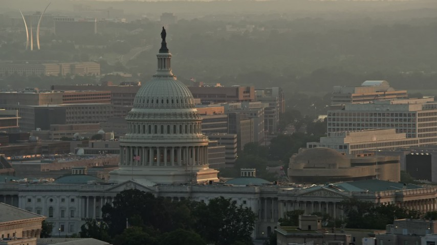 5K stock footage aerial video of the United States Capitol, US Air Force Memorial in the background, Washington D.C., sunset Aerial Stock Footage | AX76_097