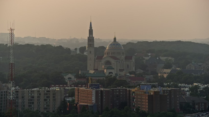 5K stock footage aerial video of Basilica of the National Shrine of the Immaculate Conception, Washington D.C., sunset Aerial Stock Footage AX76_099 | Axiom Images