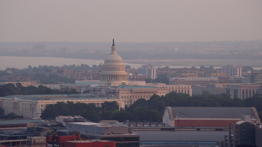 5K stock footage aerial video of Russell Senate Office Building and United States Capitol in Washington D.C., sunset Aerial Stock Footage | AX76_100