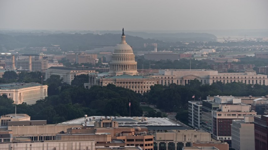 5K stock footage aerial video of Russell Senate Office Building and United States Capitol in Washington D.C., sunset Aerial Stock Footage   AX76_100E