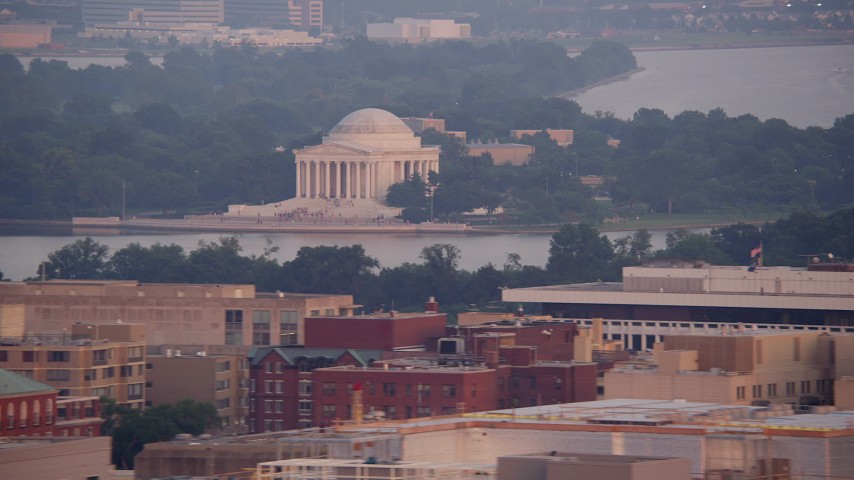 5K stock footage aerial video of The Jefferson Memorial across Tidal Basin in Washington D.C., sunset Aerial Stock Footage | AX76_108