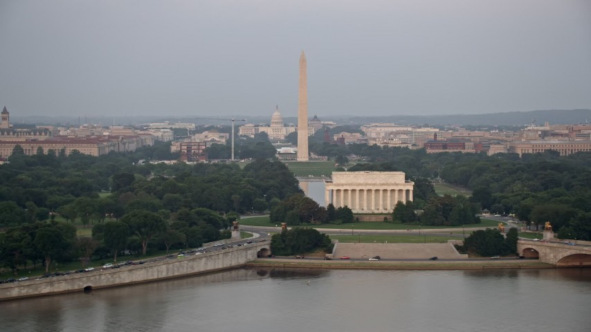5K stock footage aerial video of the United States Capitol, Washington Monument and National Mall, Lincoln Memorial, Washington D.C., sunset Aerial Stock Footage | AX76_111