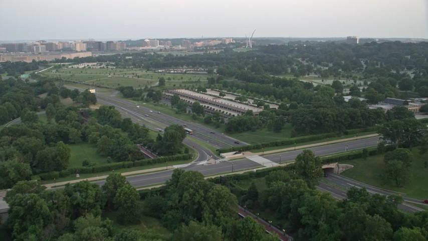 5K stock footage aerial video approaching parking structure and Visitors Center at Arlington National Cemetery, Virginia, sunset Aerial Stock Footage | AX76_112