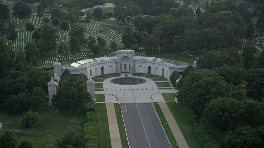 5K stock footage aerial video of the Women in Military Service for America Memorial, Arlington National Cemetery, Virginia, twilight Aerial Stock Footage | AX76_113