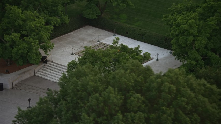 5K stock footage aerial video of President John F. Kennedy Gravesite at the Arlington National Cemetery, Arlington, Virginia, twilight Aerial Stock Footage | AX76_115