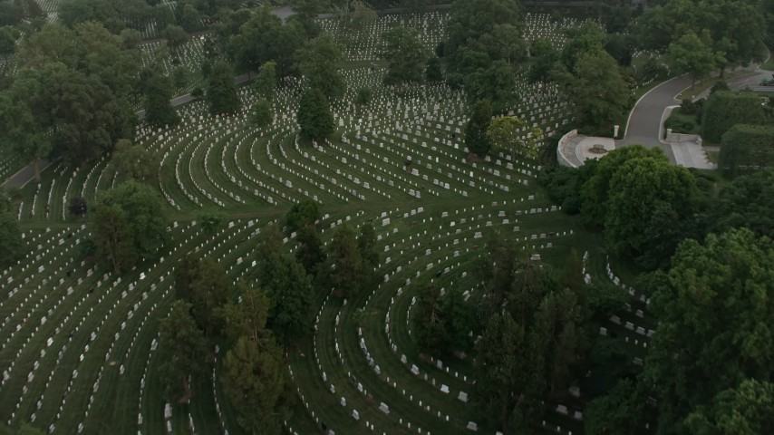 5K stock footage aerial video flying over Arlington National Cemetery gravestones, Arlington, Virginia, twilight Aerial Stock Footage | AX76_119