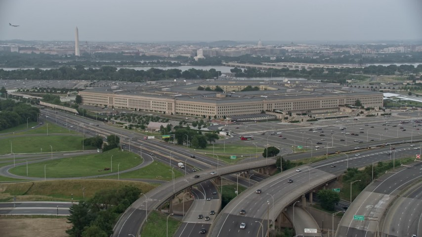 5K aerial video approaching The Pentagon, Washington, D.C., twilight Aerial Stock Footage | AX76_123