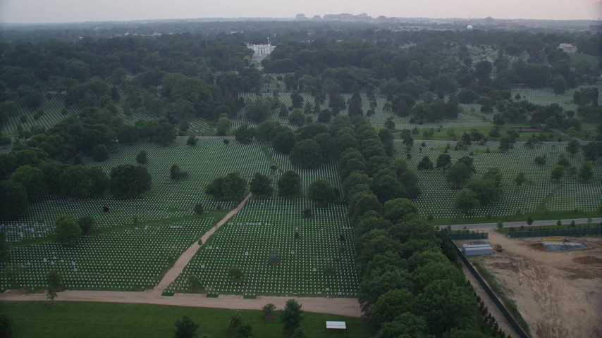 5K stock footage aerial video flying by Arlington National Cemetery, Arlington, Virginia, twilight Aerial Stock Footage | AX76_126