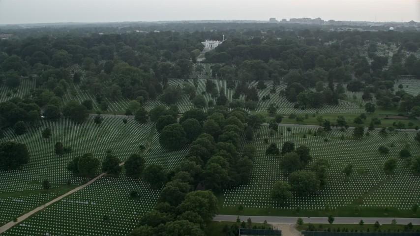 5K stock footage aerial video flying by Arlington National Cemetery, Arlington, Virginia, twilight Aerial Stock Footage | AX76_126E