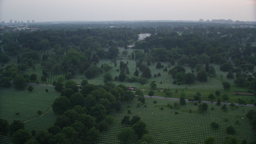 5K stock footage aerial video of rows of gravestones near Arlington House at Arlington National Cemetery, Arlington, Virginia, twilight Aerial Stock Footage | AX76_127