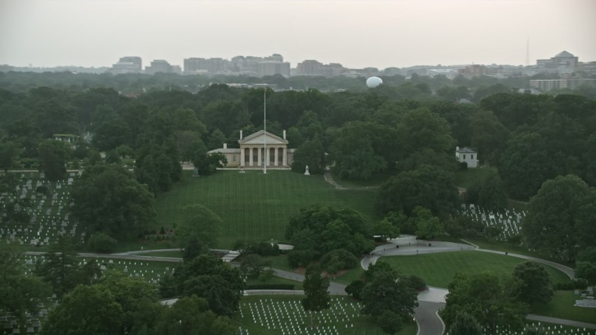5K stock footage aerial video of Arlington House and John F. Kennedy Gravesite at Arlington National Cemetery, Virginia, twilight Aerial Stock Footage | AX76_128
