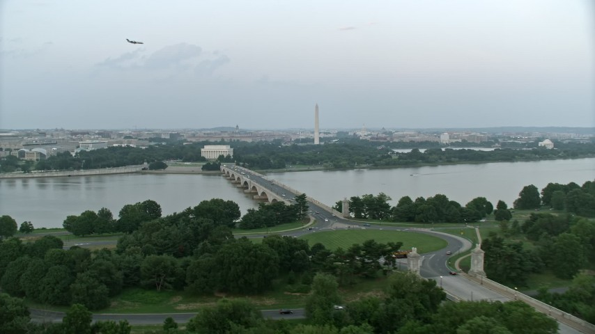5K aerial video of Lincoln Memorial, Washington Monument seen from Arlington Memorial Bridge, Washington, D.C., twilight Aerial Stock Footage | AX76_129