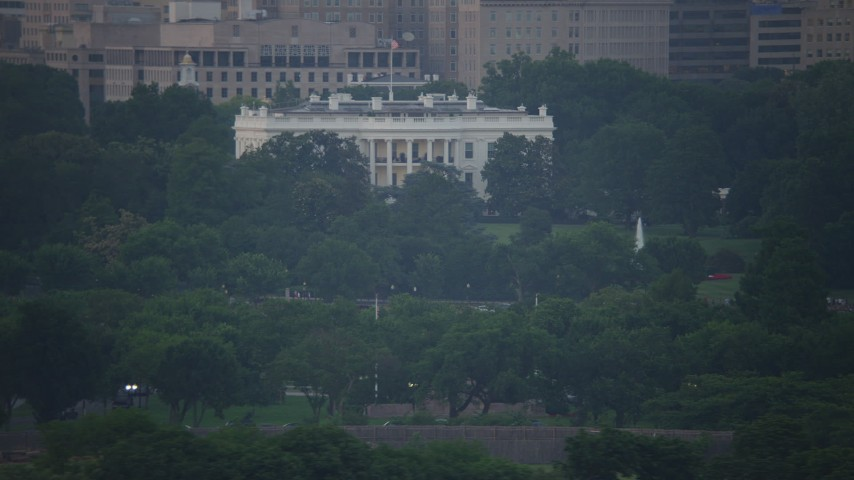 5K stock footage aerial video flying by The White House in Washington, D.C., twilight Aerial Stock Footage | AX76_131