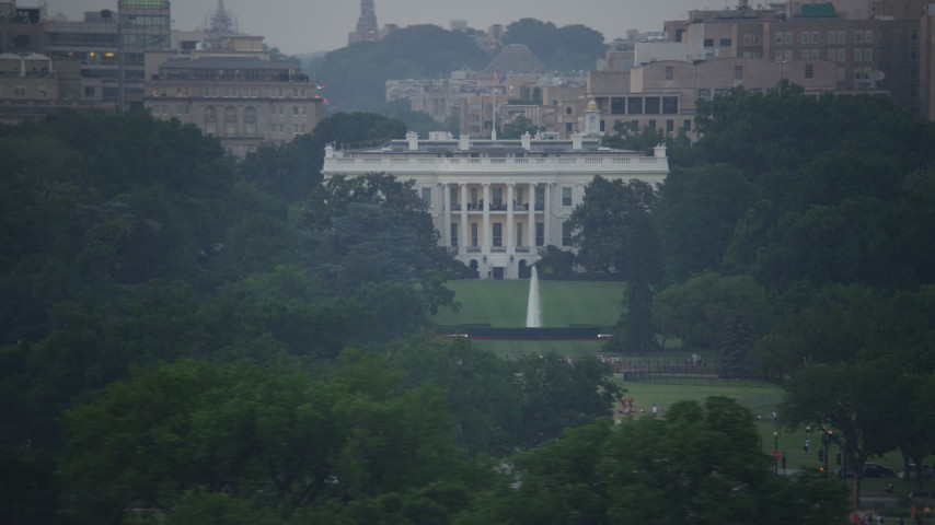 5K stock footage aerial video flying by The White House and the South Lawn Fountain in Washington, D.C., twilight Aerial Stock Footage | AX76_132