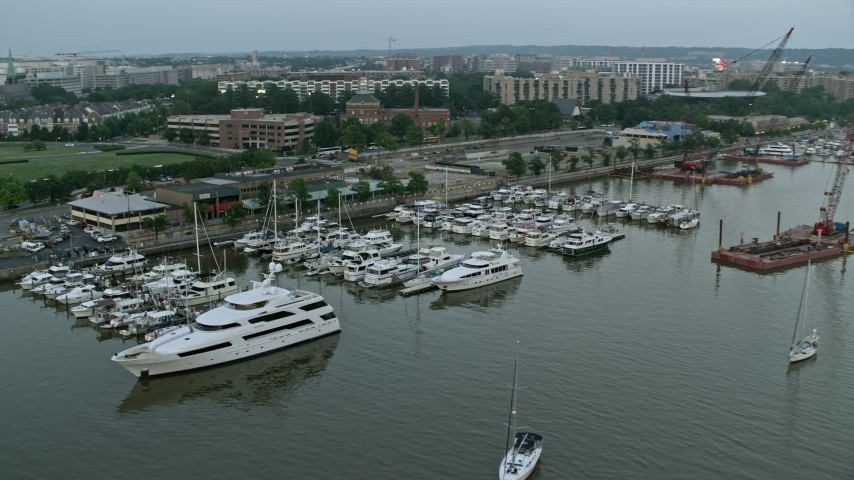 5K stock footage aerial video of Yachts docked at Gangplank Marina, Washington, D.C., twilight Aerial Stock Footage | AX76_134