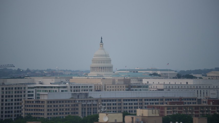 5K stock footage aerial video of office buildings and the United States Capitol, Washington, D.C., twilight Aerial Stock Footage | AX76_135
