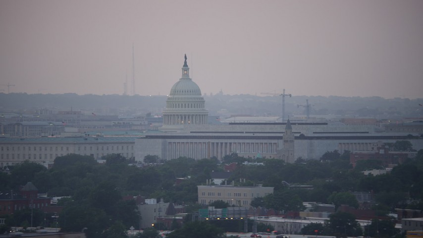 5K stock footage aerial video of the United States Capitol dome and James Madison Building in Washington, D.C., twilight Aerial Stock Footage | AX76_140