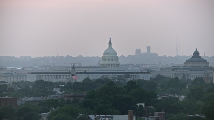 5K stock footage aerial video of the United States Capitol dome and James Madison Building in Washington, D.C., twilight Aerial Stock Footage   AX76_140E