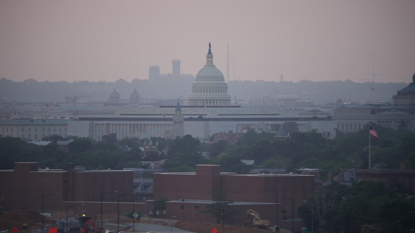 5K aerial video of the United States Capitol behind the James Madison and Thomas Jefferson Buildings, Washington, D.C., twilight Aerial Stock Footage | AX76_141