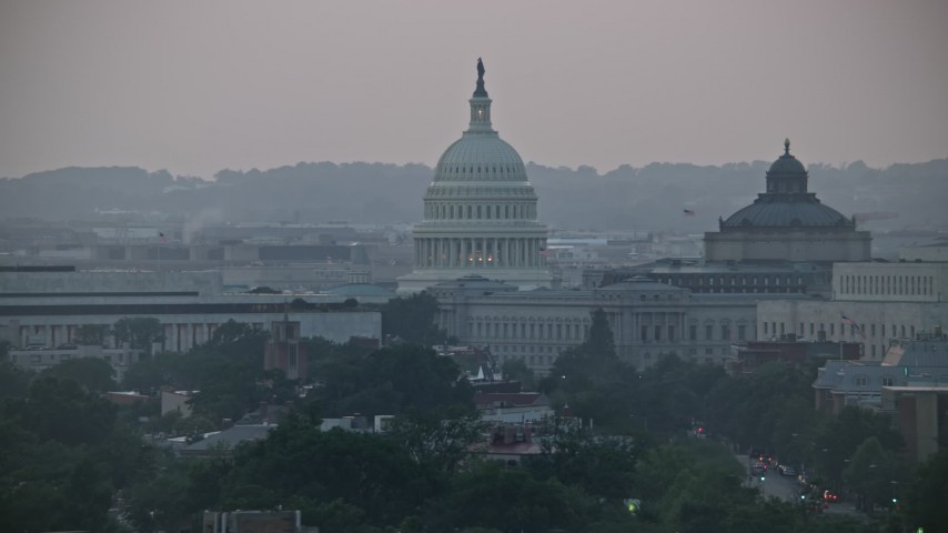 5K stock footage aerial video of the United States Capitol dome between the James Madison and Thomas Jefferson Buildings in Washington, D.C., twilight Aerial Stock Footage | AX76_142