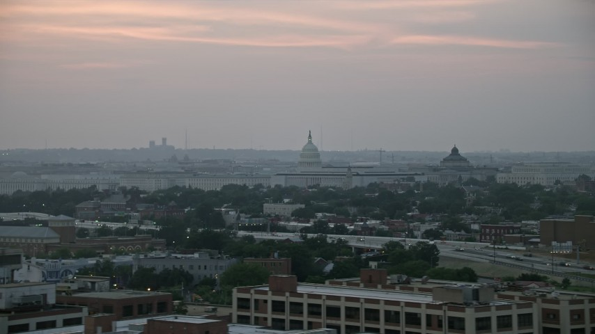 5K stock footage aerial video of the United States Capitol dome, Library of Congress, and House office buildings, Washington, D.C., twilight Aerial Stock Footage | AX76_143