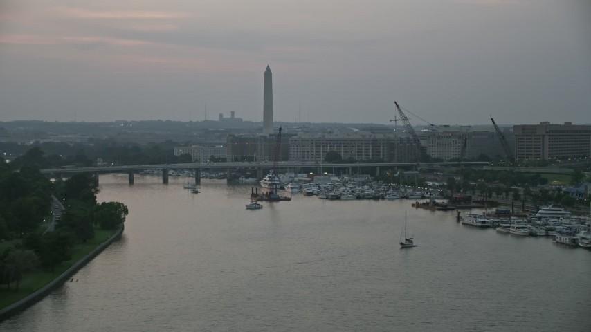 5K aerial video of Washington Monument and Francis Case Memorial Bridge, Washington, D.C., twilight Aerial Stock Footage | AX76_147