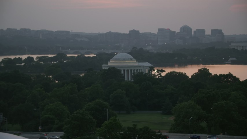 5K stock footage aerial video of the Jefferson Memorial beside Tidal Basin in Washington, D.C., twilight Aerial Stock Footage | AX76_149