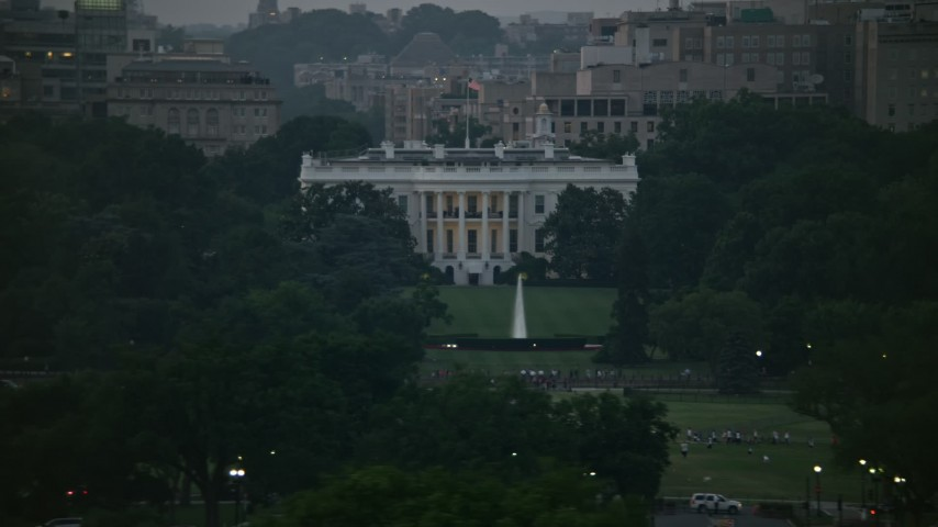 5K aerial video of the White House, eclipsed by Washington Monument, Washington, D.C., twilight Aerial Stock Footage | AX76_150