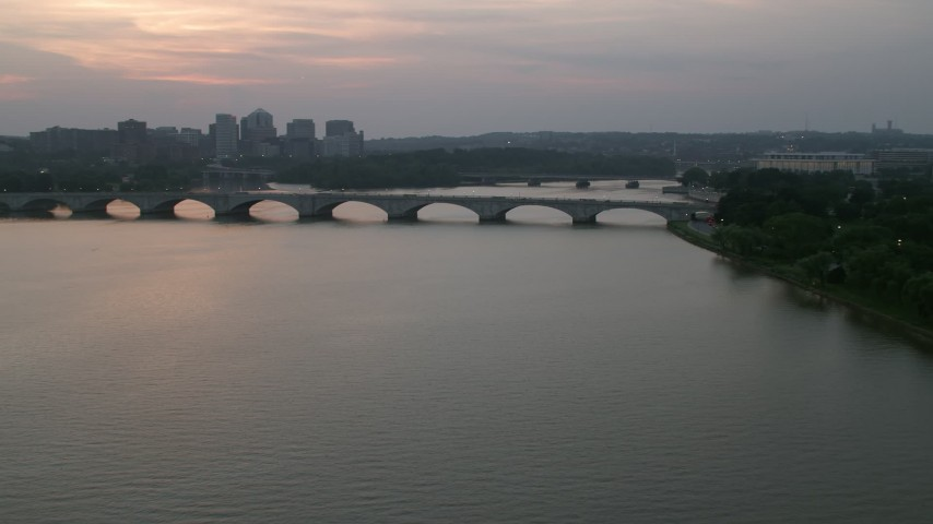 5K stock footage aerial video approaching Arlington Memorial Bridge over the Potomac River, Washington, D.C., twilight Aerial Stock Footage | AX76_152