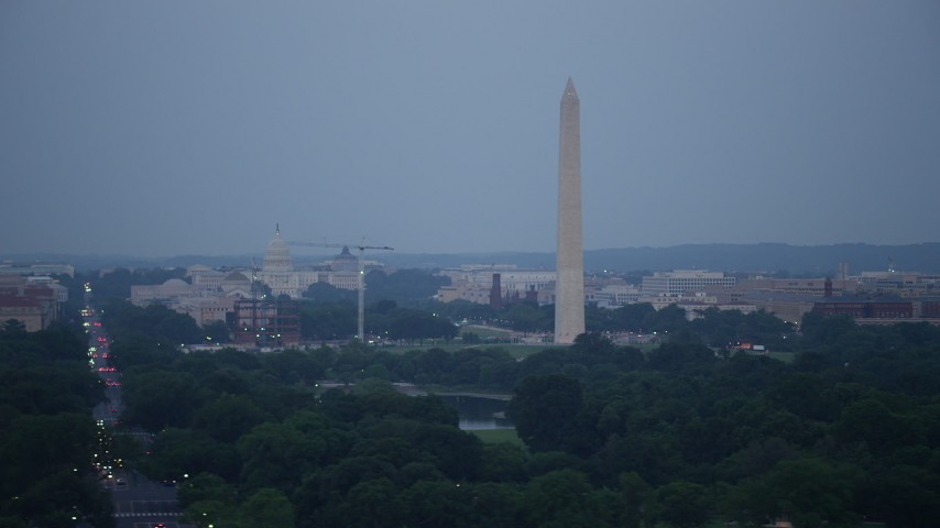 5K stock footage aerial video of the United States Capitol, Washington Monument, National Mall, Washington, D.C., twilight Aerial Stock Footage | AX76_154