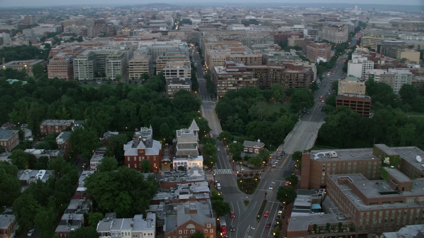 5K stock footage aerial video of Pennsylvania Avenue and M Street, Georgetown, Washington, D.C., twilight Aerial Stock Footage | AX76_156