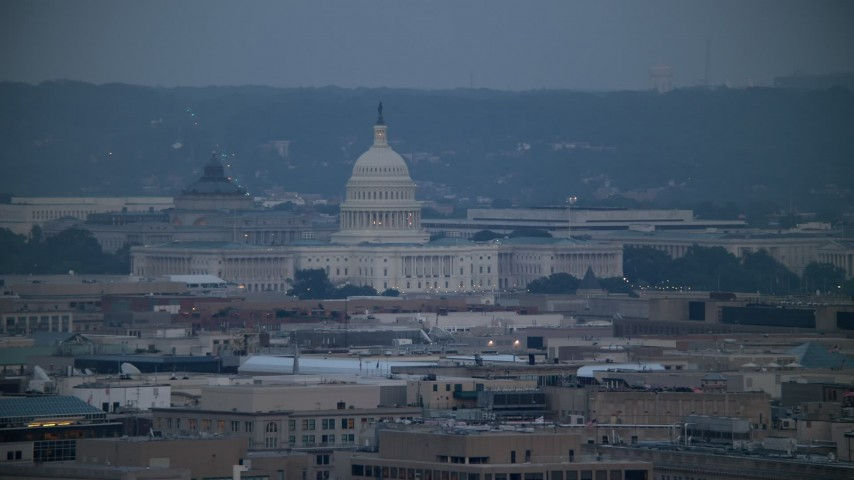 5K stock footage aerial video of the Thomas Jefferson Building and United States Capitol seen from Georgetown, Washington, D.C., twilight Aerial Stock Footage | AX76_157