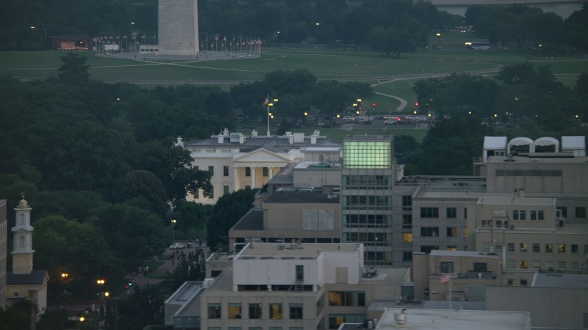 5K stock footage aerial video revealing the White House and North Lawn Fountain, Washington, D.C., twilight Aerial Stock Footage | AX76_158