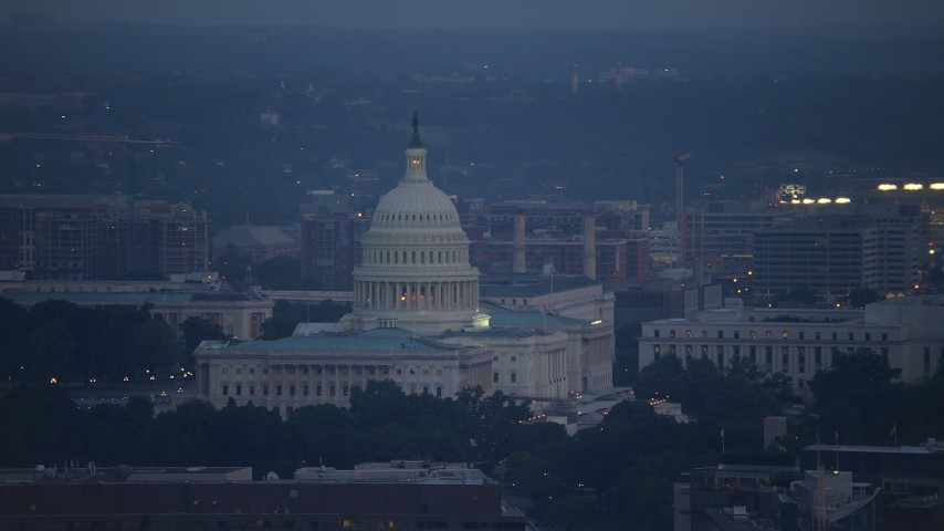 5K stock footage aerial video of the United States Capitol and the Rayburn House Office Building, Washington, D.C., twilight Aerial Stock Footage | AX76_161