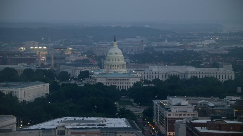 5K stock footage aerial video of the United States Capitol and the Rayburn House Office Building, Washington, D.C., twilight Aerial Stock Footage   AX76_161E