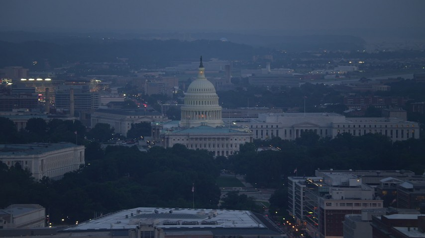 5K stock footage aerial video of the United States Capitol in front of the Rayburn House Office Building, Washington, D.C., twilight Aerial Stock Footage | AX76_162