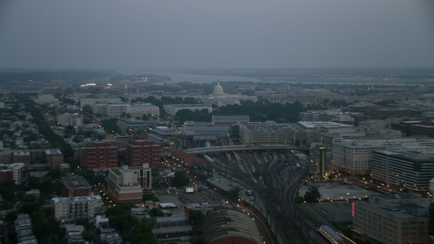 5K stock footage aerial video of United States Capitol with Potomac River in the background, Washington, D.C., twilight Aerial Stock Footage | AX76_163