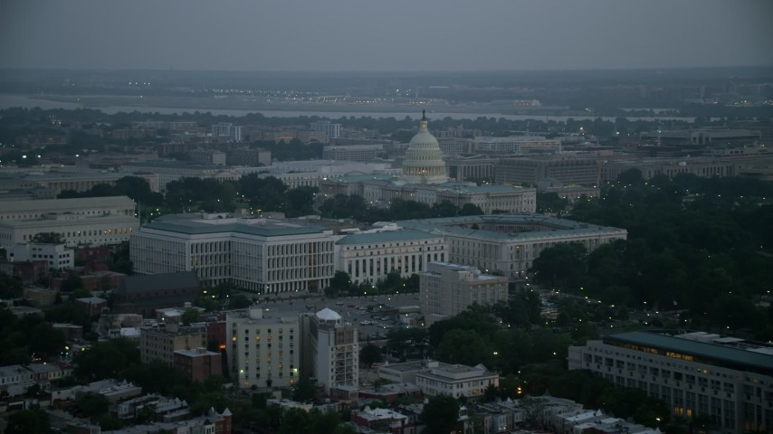 5K stock footage aerial video of the United States Capitol behind the Russell, Dirksen and Hart Senate Office Buildings, Washington, D.C., twilight Aerial Stock Footage | AX76_165
