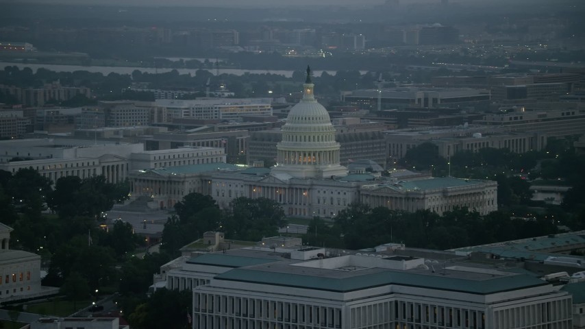 5K aerial video of the United States Capitol building in Washington, D.C., twilight Aerial Stock Footage | AX76_166