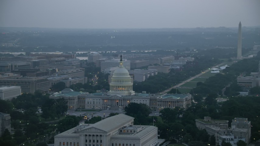 5K stock footage aerial video of United States Capitol, Washington Monument, and the Thomas Jefferson Building, Washington, D.C., twilight Aerial Stock Footage | AX76_167
