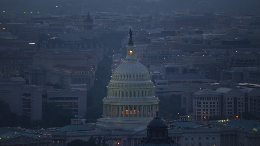 5K stock footage aerial video of the United States Capitol dome, office buildings in background, Washington, D.C., twilight Aerial Stock Footage | AX76_168