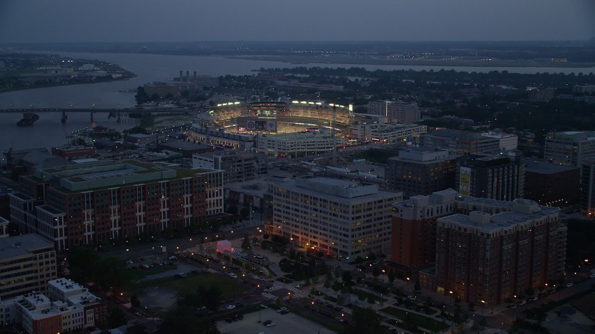 5K stock footage aerial video approaching Nationals Park during a baseball game, Washington, D.C., twilight Aerial Stock Footage | AX76_170