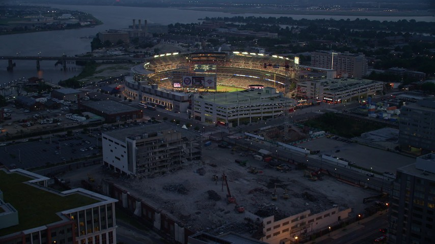 5K stock footage aerial video approaching Nationals Park during a baseball game, Washington, D.C., twilight Aerial Stock Footage | AX76_171