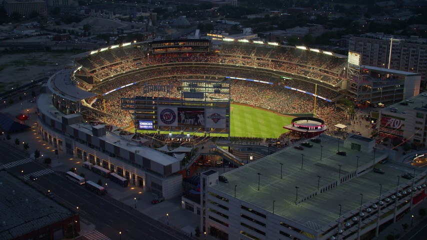 5K stock footage aerial video flying by a baseball game at Nationals Park, Washington, D.C., twilight Aerial Stock Footage AX76_172 | Axiom Images