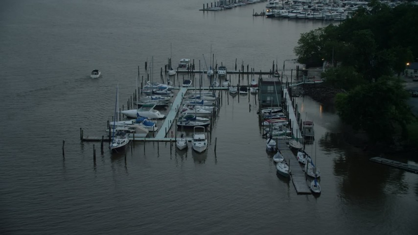 5K stock footage aerial video flying by docked boats at a marina on the Potomac River, Washington, D.C., twilight Aerial Stock Footage | AX76_174